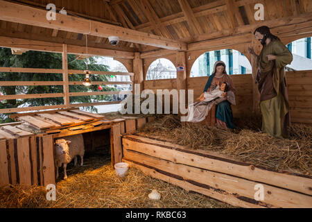 Nativity scene Christmas crib wih baby Jesus, Mary, Joseph and a sheep on Krasinskich Square in New Town in Warsaw, Poland - Stock Photo