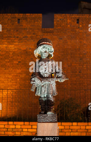 Little Insurgent (Little Insurrectionist) statue at night in city of Warsaw in Poland. Monument to the child soldiers who fought and died during the W - Stock Photo