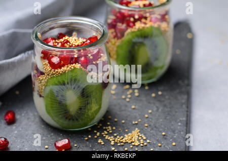 Yogurt Parfait with Puffed Quinoa, Kiwi and Pomegranate Seeds, Healthy Dessert - Stock Photo