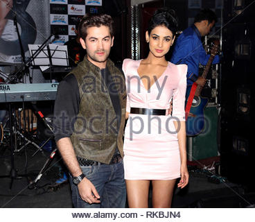 Bollywood actors Neil Nitin Mukesh and Sonal Chauhan pose during the music launch of their upcoming film 3G in Mumbai, India on February 26, 2013. The Bollywood thriller film written and directed by Shantanu Ray Chhibber and Sheershak Anand will hit the theaters on March 15, 2013. (Aakash Berde) - Stock Photo