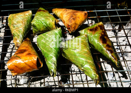 Black Sticky Rice with Coconut Milk and Taro, khao-nieo-ping Grilled stuffed Glutinous rice wrapped in banana leaves - Stock Photo
