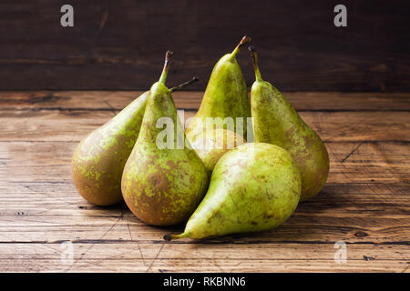 Fresh juicy Pears Conference on wooden rustic background - Stock Photo