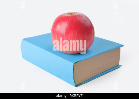 close up.book and red Apple on white background - Stock Photo