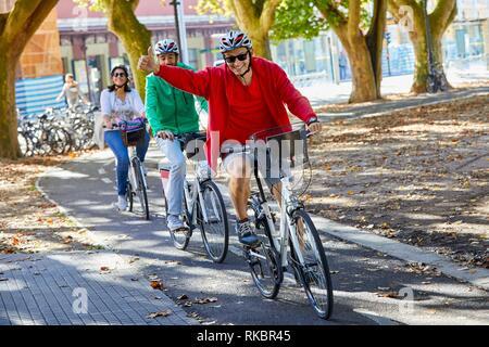 Group of tourists and guide making a bicycle tour through the city, Donostia, San Sebastian, Gipuzkoa, Basque Country, Spain, Europe - Stock Photo