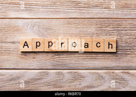 APPROACH word written on wood block. APPROACH text on wooden table for your desing, concept. - Stock Photo