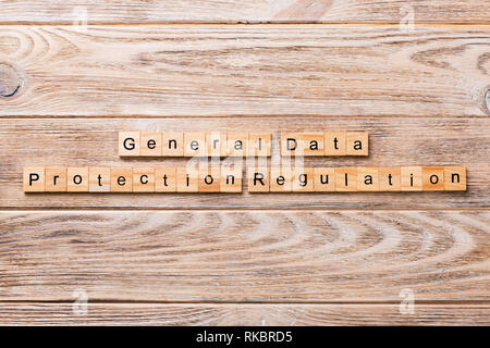 GDPR word written on wood block. General Data Protection Regulation text on wooden table for your desing, concept. - Stock Photo