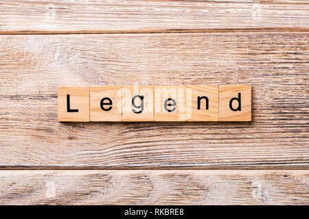 legend word written on wood block. legend text on wooden table for your desing, concept. - Stock Photo