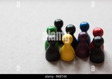 Wooden figures in different colors - Stock Photo