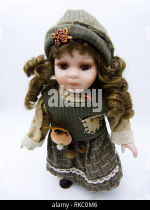 Ceramic old dolly with brown eyes on white background - Stock Photo
