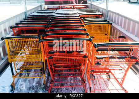Supermarket mall shopping cart outside in snow - Stock Photo