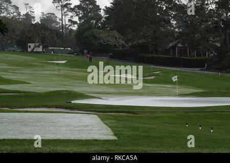Pebble Beach Golf Links, California, USA. 10th Feb 2019.   Hail stops play during the final round at Pebble Beach Golf Course at  the AT&T Pro-Am at Pebble Beach (here the 15th hole looks like a ski slope) Credit: Motofoto/Alamy Live News - Stock Photo