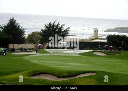 Pebble Beach Golf Links, California, USA. 10th Feb 2019.   Hail stops play during the final round at Pebble Beach Golf Course at  the AT&T Pro-Am at Pebble Beach (here the 3rd hole with hail on the green Credit: Motofoto/Alamy Live News - Stock Photo