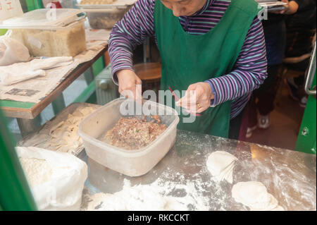 London, UK. 10th Feb, 2019. Chinese dumplings being prepared near Leicester Square in London, England, UK., during Chinese New Year celebrations. Credit: Ian Laker/Alamy Live News. - Stock Photo