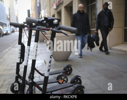 Dallas, Texas, USA. 16th Nov, 2018. Electric scooters stand along the streets of downtown Dallas, Texas. The public scooters are available to rent as a means of transportation throughout the city. Credit: Eliott Foust/ZUMA Wire/Alamy Live News - Stock Photo