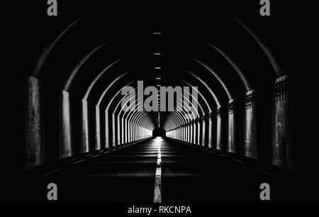 Dramatic Black White Monochrome Highway Tunnel Night Time Light Shapes Dark Abstract - Stock Photo