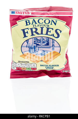 Winneconne, WI - 5 February 2019: A package Smiths bacon flavor fries chips on an isolated background - Stock Photo