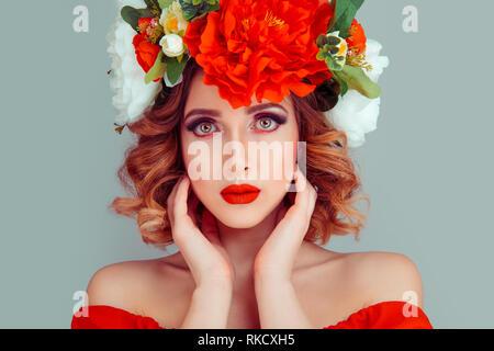 Beautiful young woman wearing floral headband  - Stock Photo