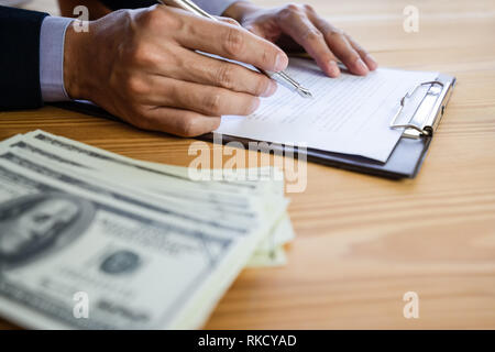Business man signing a contract. Owns the business sign personally,director of the company, solicitor. Real estate agent holding house, moving home or - Stock Photo