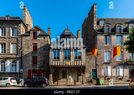 Dinan, France - July 23, 2018: Picturesque old houses in historic centre of the city. - Stock Photo