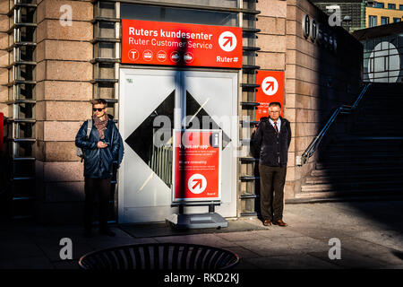 Two guys waiting in front of the Ruter customer service office in Oslo - Stock Photo