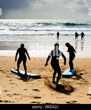 Surfing school learning how to surf at the beach. Portugal
