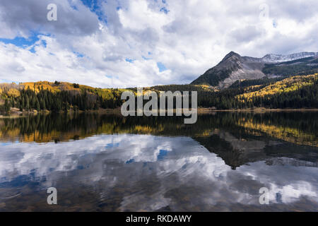 This is a view from Lost Lake Campground which offers a grand view and reflection of East Beckwith Mountain in Lost Lake Slough. - Stock Photo