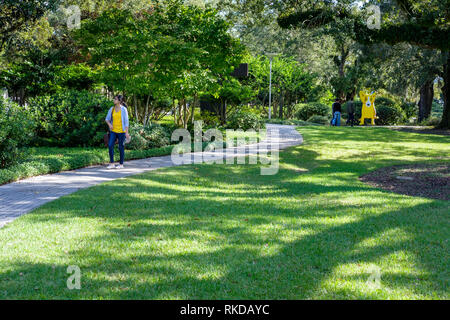 Visitors on park grounds of New Orleans Sculpture Garden New Orleans, Louisiana, United States of America, USA - Stock Photo