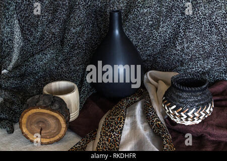 Earthy coloured still life photograph with archaic wooden and ceramic objects - Stock Photo
