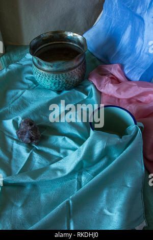 Pastel coloured still life photograph with archaic objects - Stock Photo