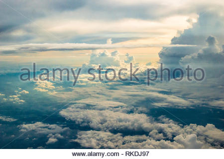 Dramatic cumulonimbus cloudscape after a rainy day, as photographed from a plane. Beautiful sunset sky. - Stock Photo