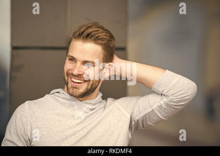 Man confident in his antiperspirant. Prevent, reduce perspiration. No sweat - deodorant works. Guy checks dry armpit satisfied with clean clothes. Sportsman after training pleased with antiperspirant. - Stock Photo