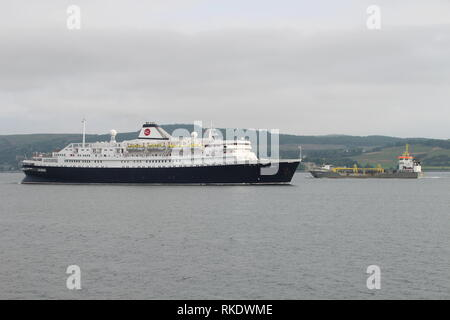 The cruise ship MV Astoria heads in to Greenock Ocean Terminal, as the dredger Freeway passes in the opposite direction. - Stock Photo