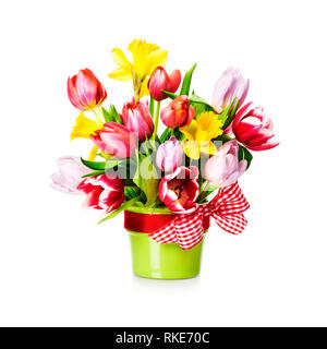 Tulips and daffodils in green vase with bow. Spring flowers bouquet isolated on white background. Design element - Stock Photo
