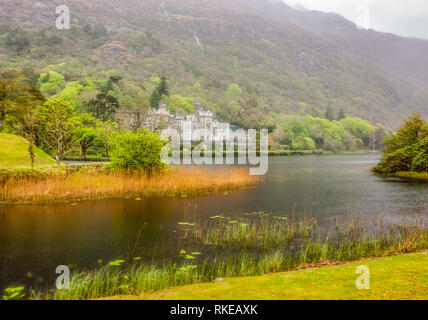 Kylemore Abbey in Connemara, a region in Ireland - Stock Photo