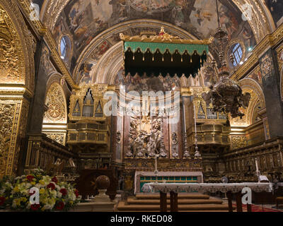 St John's Co-Cathedral in Valetta Malta, from 1577 a fine example of high baroque architecture, interior view of the main altar - Stock Photo