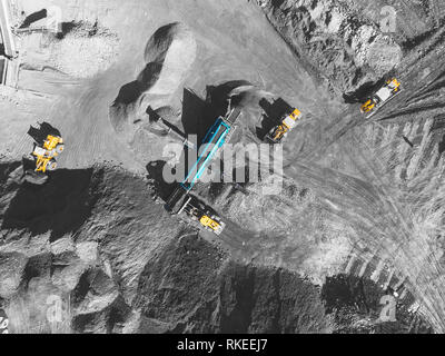 View from above, on the process of sorting coal mined. Open pit mine, Mining coal extractive industry anthracite - Stock Photo