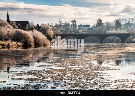 Kelso, Scottish Borders, UK. 1st February 2019. Ghillies and fly fishers had to contend with a frozen River Tweed at Kelso as the Salmon season opened - Stock Photo