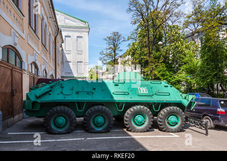 Kyiv, Ukraine - May 10, 2015: An armoured personnel carrier (APC) in front of the Ukrainian National Chornobyl Museum, dedicated to the 1986 Chernobyl - Stock Photo