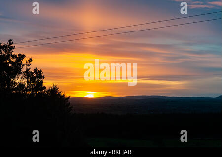 Ballydehob, West Cork, Ireland. 11th Feb, 2019. The sun rises over Ballydehob as a prelude to a mainly dry and bright day. Top temps of 7 to 10° Celsius. Credit: Andy Gibson/Alamy Live News - Stock Photo