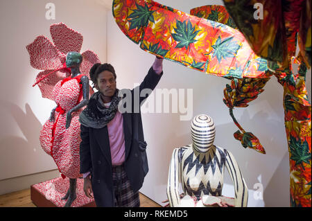 Somerset House, London, UK. 11th Feb, 2019. Designers putting the finishing touches to their display in 16 different room installations at International Fashion Showcase 2019 previews ahead of London Fashion Week. Image: Rwandan fashion designer Cedric Mizero finishes his installation Dreaming My Memory. Credit: Malcolm Park/Alamy Live News - Stock Photo