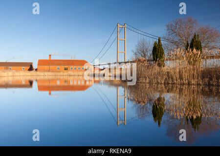 Barton-upon-Humber, Lincolnshire, UK. 11th Feb, 2019. UK Weather: A beautiful blue sky and reflections at The Old Tile Works and Humber Bridge. Barton-upon-Humber, North Lincolnshire, UK. 11th February 2019. Credit: LEE BEEL/Alamy Live News - Stock Photo