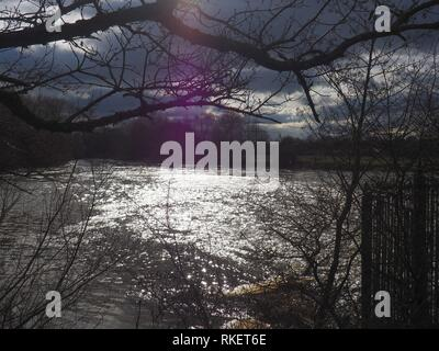 Oxford, UK. 11th Feb 2019. UK Weather. The sun briefly breaks through the clouds to shine on the Thames at Sandford. Credit: Angela Swann/Alamy Live News - Stock Photo
