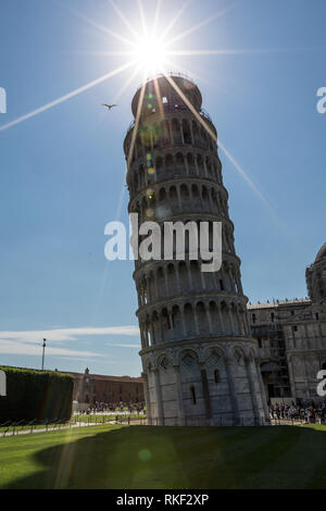 The Leaning Tower of Pisa is known worldwide for its unintended tilt to one side in Tuscany, Italy. - Stock Photo