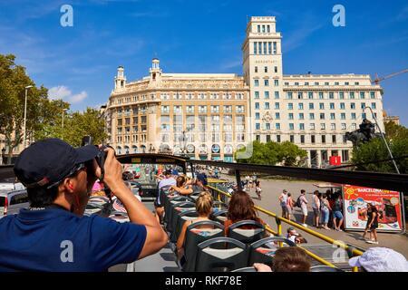 Tourists on bus making City Tour, Plaça de Catalunya, Barcelona, Catalunya, Spain, Europe - Stock Photo