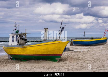 Fishing boats on a Baltic Sea beach in Rewal village, West Pomeranian Voivodeship of Poland. - Stock Photo