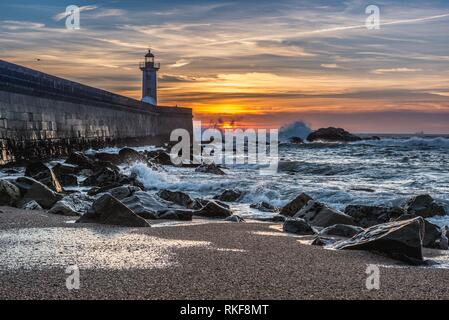 View from Carneiro beach on a Felgueiras Lighthouse during sunset over Atlantic Ocean in Foz do Douro district of Porto city, Portugal. - Stock Photo
