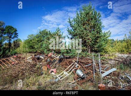 Scrap metal on abandoned Yaniv town railway station, Chernobyl Nuclear Power Plant Zone of Alienation around the nuclear reactor disaster in Ukraine. - Stock Photo