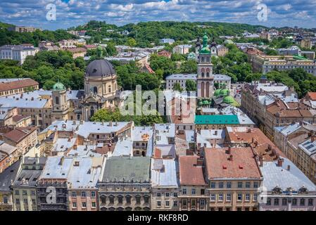Aerial view from tower of Town Hall with Corpus Christi Dominican Church (left) and Dormition Church also known as Wallachian Church in Lviv city, - Stock Photo