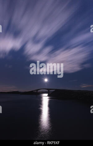 Night with the moon and view on the Atlantic Ocean Road (Atlanterhavsveien) in Norway. Wintertime landscapes and colours. - Stock Photo