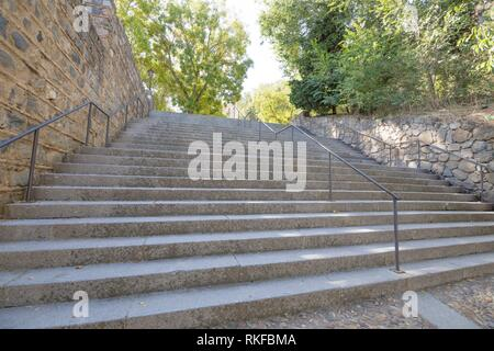 stone stairs with metal balusters going up in Toledo city, Spain, Europe. - Stock Photo